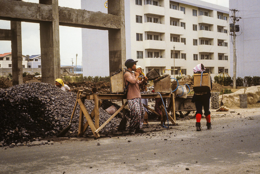 Older women or ajummas helping out with construction.  Echoes of Jeju: A Photo Essay of Korean Island Life in 1979 (Part 1)