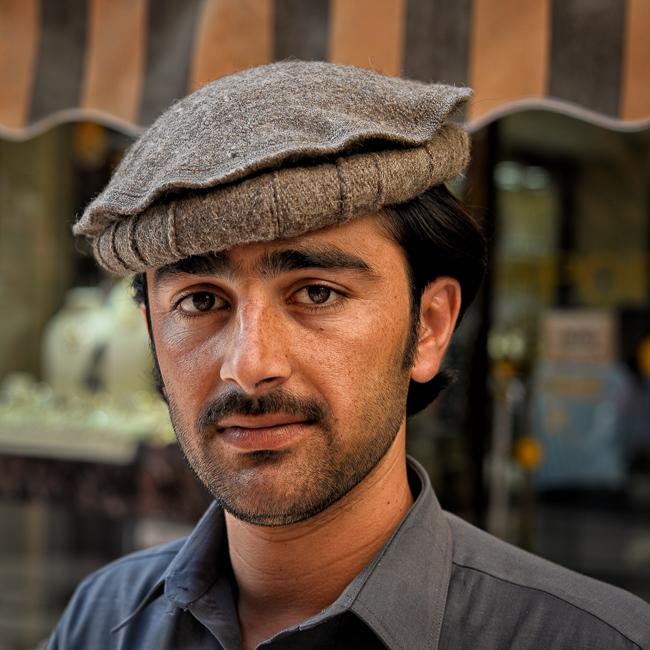 Adventure, Afghanistan, Deira, Dubai, Gold Souk, Middle East, Nomad Within, Peter DeMarco, UAE, United Arab Emirates, man, photography, portrait, scarf vendor, travel