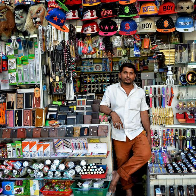 Adventure, Deira, Dubai, Kerla, Middle East, Nomad Within, Peter DeMarco, UAE, United Arab Emirates, hats, indian, masks, photography, portrait, travel, vendor, watches