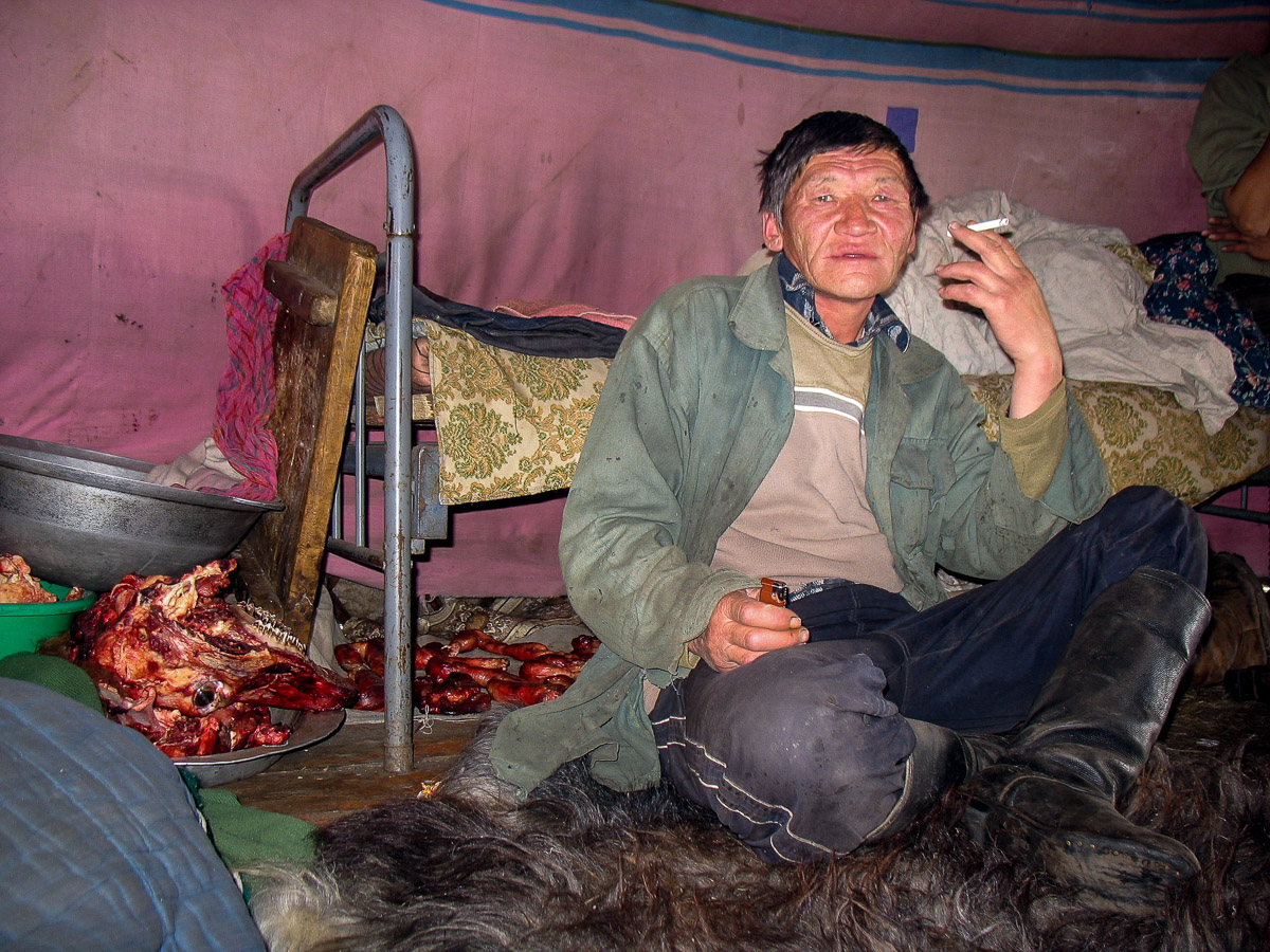 Smoking a cigarette in yurt